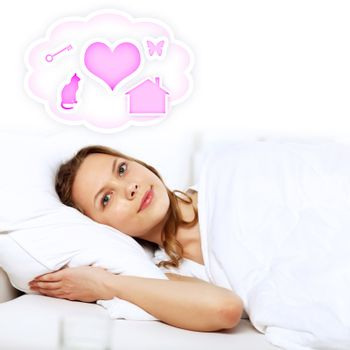 Young woman in white with heart symbols