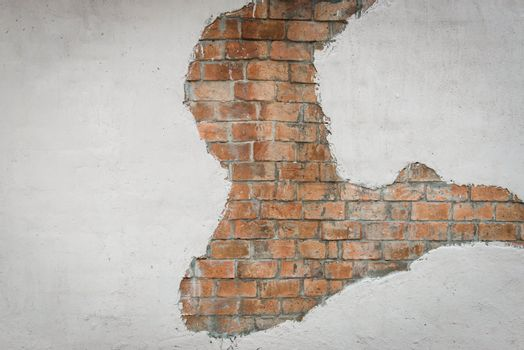 Brown brick wall with white painted concrete pattern, useful for background design