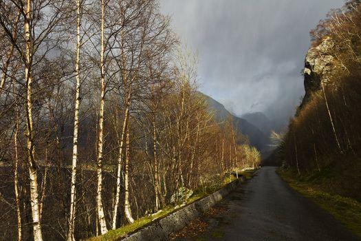 unused, run-down road in rural landscape - norway