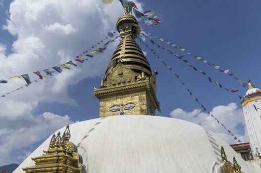 temple of swayabhunath in kathmandu, nepal with clouds and blue sky  in background