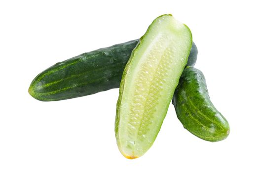 Green whole and sliced cucumbers vegetables isolated on white background. Studio photo
