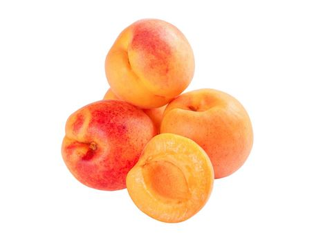 Group ripe apricot fruits isolated on white background