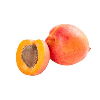 Whole and half ripe apricot fruits isolated on white background