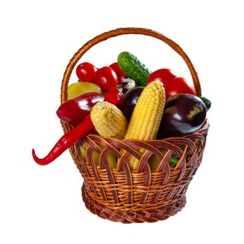 Different fresh vegetables in wicker basket isolated on a white background