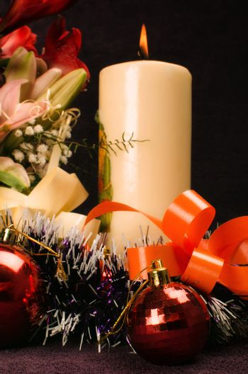 Christmas baubles with flower and candle