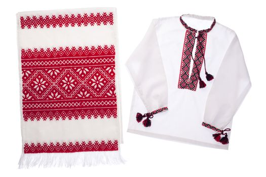 National Ukrainian traditional ornate handicraft symbol embroidery in red cross-stitch handmade white towel and cotton vyshyvanka men's shirt with ornamental pattern isolated