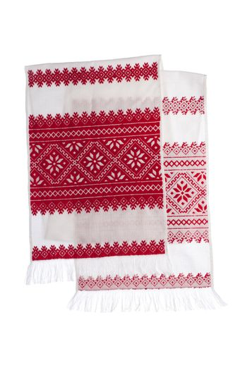 National Ukrainian traditional ornate craftsmanship symbol embroidery in red cross-stitch handmade white towel with ornamental pattern isolated