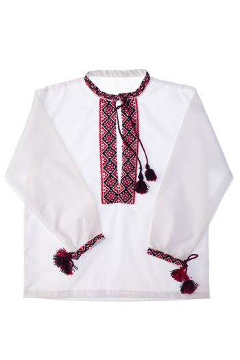 National Ukrainian traditional ornate handicraft symbol embroidery in red cross-stitch handmade white cotton men's shirt vyshyvanka with ornamental pattern isolated