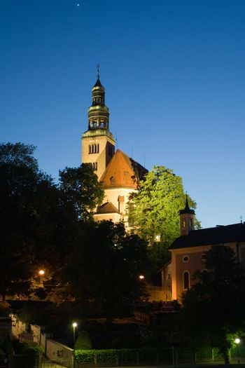 Chapel and bell-tower in old European city in the evening