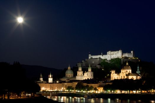 Old town and fortress on the hill in Salzburg at night