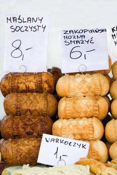 Homemade smoked polish cheese oscypki close-up on the craft market counter in Zakopane