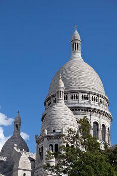 France Paris landmark Basilika Saint Heart on Montmartre Basilique du Sacré Cœur on the blue sky background