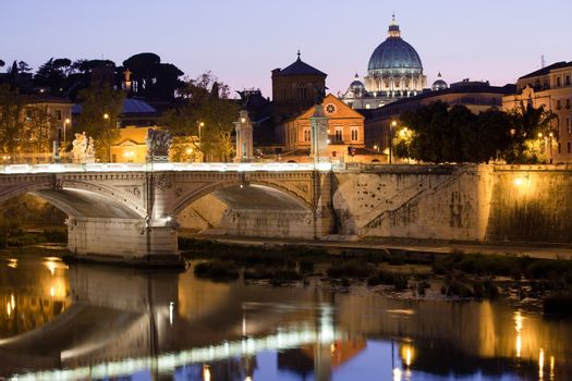 Cityscape of Saint Peter's basilica Vatican Rome Italy and Vittorio Emanuele bridge on Tiber bank in twilight