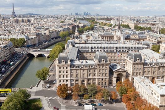 Top view from cathedral Notre Dame on river Seine, bridge Saint Michel and Neuf, roofs, housetops, streets, center, downtown, tower Eiffel in Paris France in autumn