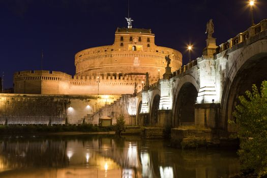 Tiber bank, arch stone bridge and reflection, museum, ancient Adrian mausoleum and medieval castle Saint Angel with statue archangel Michael  in Rome Italy at twilight