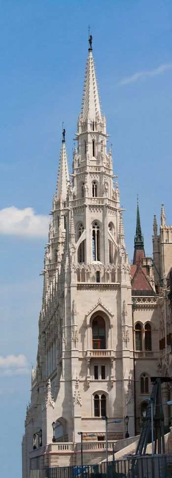 Panoramic steeple gothic revival style towers of Hungariuan governmant landmark Parliament by Imre Steindl in Budapest on blue sky background
