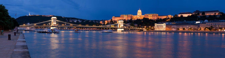 Panoramic night cityscape on landmark Gellert and castle hill Buda, baroque royal palace, Szechenyi chain bridge over Danube river in twilight Budapest Hungary