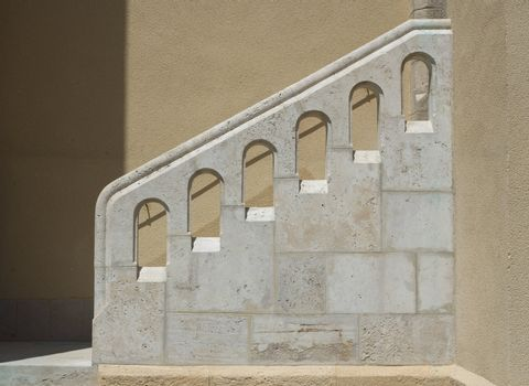 Outside stairs and white stone handrail. Architectural element in Mediterranean style