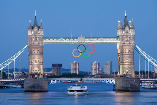 Landmark Tower bridge on river Thames illuminated and decorated with symbol 5color rings  before Olympic games  in London 2012 Great Britain at twilight