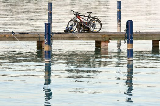 Bicycles are left on the lake bridge. Tranquil scene