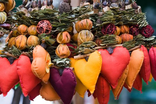 Handicraft decor, souvenir for Valentine's day.  Strings of dried leaves, fruits and cloth hearts