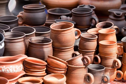 Rustic handmade ceramic clay brown terracotta cups souvenirs at street handicraft market