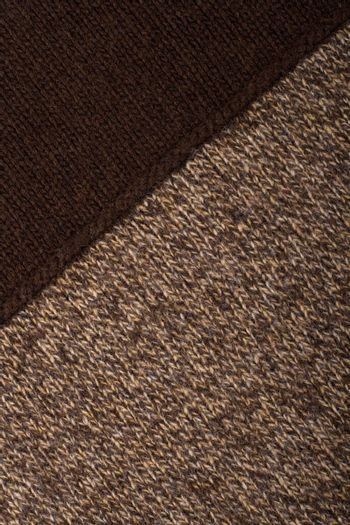 Knitted textile from two dark brown and speckled patterns Backgrounds Abstract