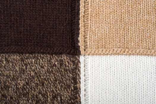 Knitted textile from four beige, white, brown and speckled brown patterns Backgrounds Abstract