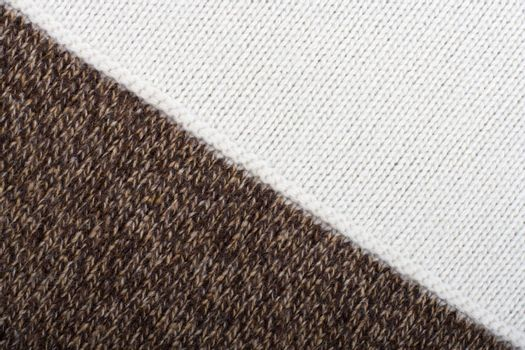 Knitted textile from two brown speckled and white patterns Backgrounds Abstract