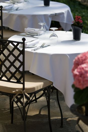 Set table for two on the summer terrace and free chair