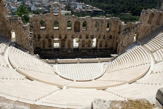 Ancient amphiteatr Odeon Gerodes Atticus in Acropol Greece with Athens city view