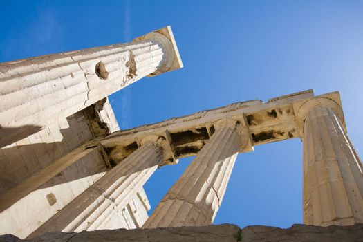 Columns of entrance propylaea to ancient temple Parthenon in Acropolis Athens Greece on blue sky background