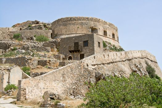 Abandoned ruin medieval fortress, leper colony on Spinalonga Kalydon island Crete Greece