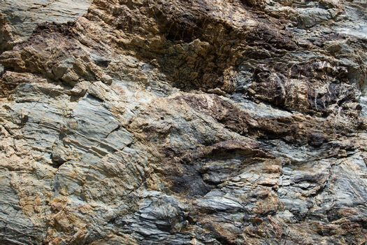 Dark brown with striae rock stone pattern, textured background