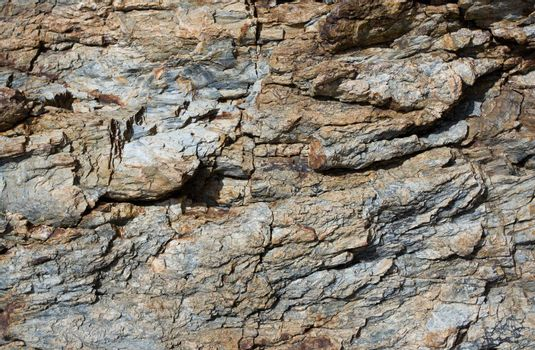 Rusty and gray striae on rock stone pattern, textured background