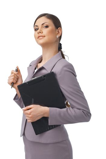 Portrait of a young confident businesswoman holding a clipboard and a pen
