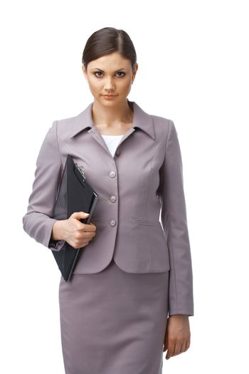 Portrait of a young confident businesswoman holding a clipboard