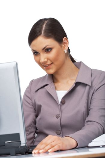 Business young woman sitting at her desk looking surprised on her laptop