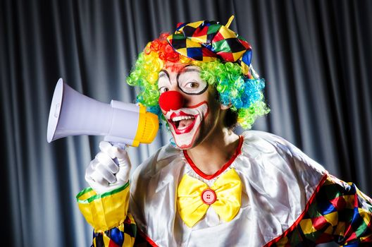 Clown in studio with loudspeaker