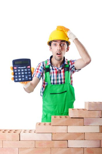 Expensive construction concept with builder and calculator