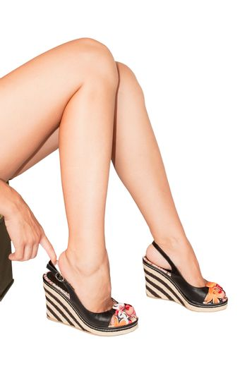 Beautiful woman's legs with summer shoes isolated