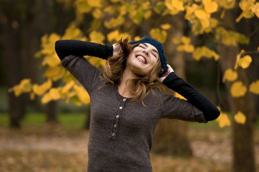 Happy woman in a beautiful autumn day