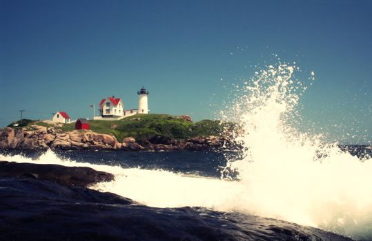 Waves crashing in front of Nubble Lighthouse