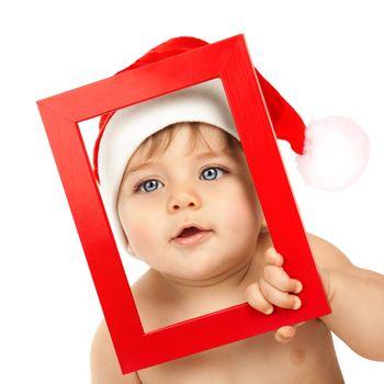 Baby boy wearing Santa Claus hat