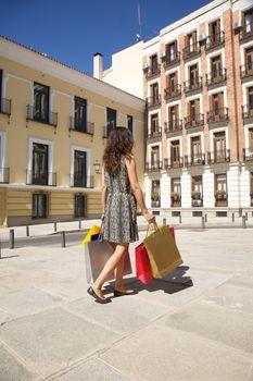 consumerism woman at corner street