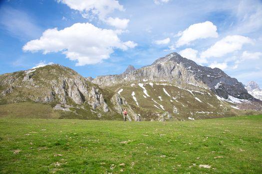 great rock mountain and far woman
