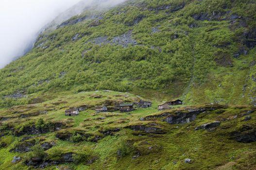 Log cabins on hillside