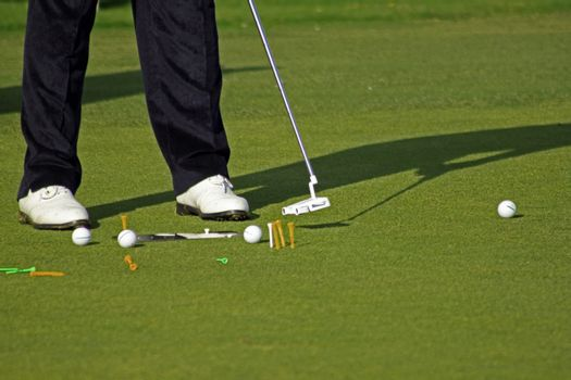 Pro golfer set up for practicing his putting stance