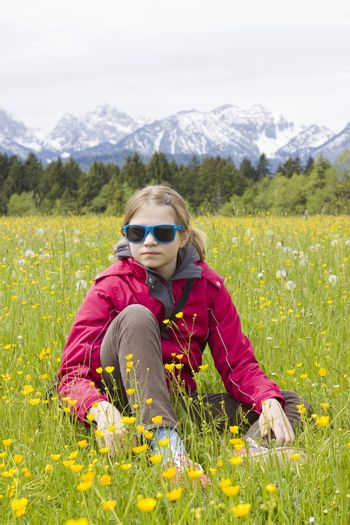 portrait of a girl against the panorama of the Alps