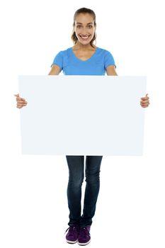 Trendy woman displaying blank billboard